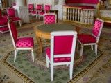 Chair and table of purplish red color