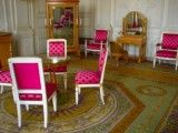 Room with chair of purplish red color