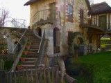 Rural cottage on water mill and the stairs that is