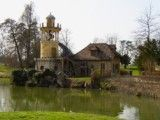 Rural cottage and pond with towers
