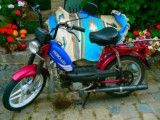Motorcycle of purplish red color