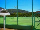 View of seen tennis court in mountain