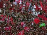 Reds stand where Brazilian national flag is shaken