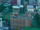 High school in the center of a city seen from the sky
