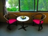 Chair & table & and ashtray on window side